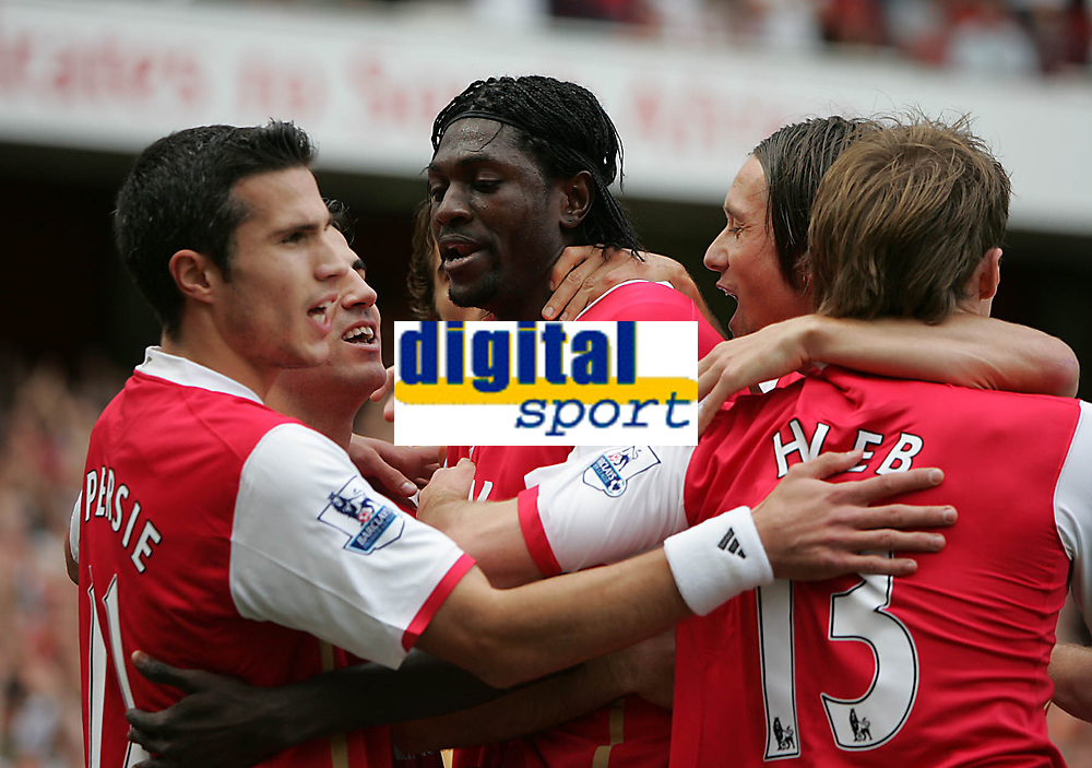 Photo: Lee Earle.<br /> Arsenal v Portsmouth. The FA Barclays Premiership. 02/09/2007.Emmanuel Adebayor (C) is congratulated after scoring their opening goal.