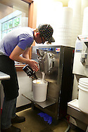 Ice Cream flavored with beer at Salt & Straw, an ice cream scoop shop in Portland, Oregon.  Tyler Malek adding ingredients to the ice cream machine.