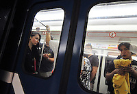 Passengers just before the interior station doors close. With 5 lines, the metro in St. Petersburg, Russia is fast, clean, and efficient. Built deep and made to last, the system serves the five million residents of this sophisticated city well.