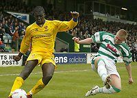 Fotball<br /> Photo. Andrew Unwin, Digitalsport<br /> NORWAY ONLY<br /> <br /> Yeovil v Cheltenham, Nationwide League Division Three, Huish Park, Yeovil 10/04/2004.<br /> Yeovil's Steven Reed (r) tries to block a cross from Cheltenham's Damian Spencer (l).