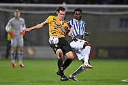 Cambridge United forward Joe Ironside  (9)  and Sheffield Wednesday defender Cheyenne Dunkley  (22)  battles for possession during the EFL Sky Bet League 1 match between Cambridge United and Sheffield Wednesday at the Abbey Stadium, Cambridge, England on 19 October 2021.
