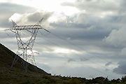 Riders crest a rise near a power pylon during stage 3 of the 2014 Absa Cape Epic Mountain Bike stage race held from Arabella Wines in Robertson to The Oaks Estate in Greyton, South Africa on the 26 March 2014<br /> <br /> Photo by Greg Beadle/Cape Epic/SPORTZPICS