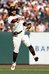 San Francisco Giants shortstop Brandon Crawford (35) leaves his feet to throw out San Diego Padres San Diego Padres' Jake Cronenworth at first base during the eighth inning of a baseball game, Saturday, Oct. 2, 2021, in San Francisco. (AP Photo/D. Ross Cameron)