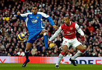 Photo: Ed Godden/Sportsbeat Images.<br /> Arsenal v Wigan Athletic. The Barclays Premiership. 11/02/2007. Wigan's Fitz Hall (L), controls the ball as he is approached by Thierry Henry.