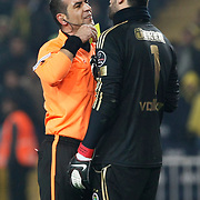Referee's Bunyamin GEZER show the yellow card to Fenerbahce's goalkeeper Volkan DEMIREL (R) during their Turkish superleague soccer derby match Fenerbahce between Trabzonspor at the Sukru Saracaoglu stadium in Istanbul Turkey on Sunday 30 January 2011. Photo by TURKPIX