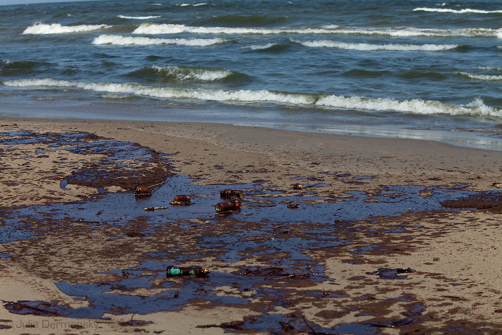 OIl from the BP oil spill on Grand Isle. The BP Oil  Spill contaminated the marshes and washed up on the shores of bird estuaries along the Gulf Coast.