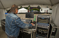 Front house engineer Ray Durso checks the audio system for one the stages at Laconia Fest on Thursday afternoon.  (Karen Bobotas/for the Laconia Daily Sun)