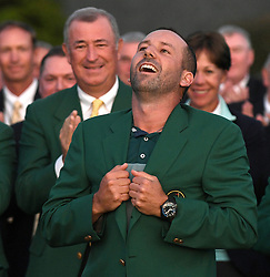 April 9, 2017 - Augusta, Georgia, U.S.- Sergio Garcia gets the feeling of his green jacket after winning the Masters Tournament on Sunday. Garcia won the tournament by defeating Justin Rose in a one-hole playoff on the 18th green at Augusta National Golf Club. (Credit Image: © Jeff Siner/TNS via ZUMA Wire)