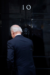 US Vice President Joe Biden knocks on the door of No10 Downing Street as he arrives at No10 Downing Street for meetings with the Deputy Prime Minister Nick Clegg then a working lunch with Prime Minister David Cameron, London, Tuesday February 5, 2013. Photo By Andrew Parsons / i-Images