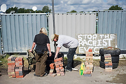 © Licensed to London News Pictures. 18/09/2011. Crays Hill, UK. Supporters of the Dale Farm residents help prepare for the eviction of  around 80 traveller families from the UK's largest illegal site,  which is due to start tomorrow (Mon). Barricades are being built to prevent entry to the site. Photo credit: Ben Cawthra/LNP