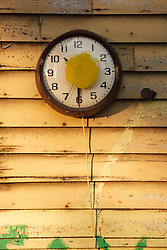 Clock and yellow dot, Heidelberg Project, Detroit, Michigan.  The Heidelberg Project is a grass roots project started by artist Tyree Guyton that uses art to help revitalize the embattled neighborhood.  Each year, over 275,000 people visit the project .  For more information, go to www.heidelberg.org