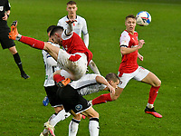 Football - 2020 / 2021 Sky Bet Championship - Swansea City vs Rotherham United - Liberty Stadium<br /> <br /> An airborne Daniel Barlaser Rotherham United falls on the back of Jay Fulton Swansea City  in a match played without fans<br /> <br /> COLORSPORT/WINSTON BYNORTH
