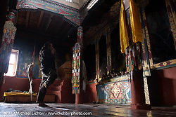 Cool Beans Chris Marino in a Buddhist temple in Muktinath during Motorcycle Sherpa's Ride to the Heavens motorcycle adventure in the Himalayas of Nepal. On the fourth day of riding, we went from Kalopani to Muktinath. Thursday, November 7, 2019. Photography ©2019 Michael Lichter.