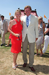 BROOK and SALLY JOHNSON she was Sally Faber at the Veuve Clicquot sponsored Gold Cup Final or the British Open Polo Championship held at Cowdray Park, West Sussex on 17th July 2005.<br />