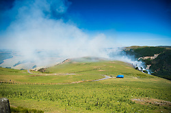 ©Licenced to London News Pictures<br /> Aberystwyth Wales UK, June 27 2018<br /> <br /> UK Weather:  A forest fire that started yesterday is still raging along the steep hillsides of the Rheidol Valley, a few miles inland of Aberystwyth in Mid Wales.<br /> The terrain makes it impossible for fire-crews to get their vehicles close tot he flames, and the fire is being dealt with by a specialist helicopter team who are dropping tons of water, scooped up from the river below, onto the burning trees.<br /> <br /> <br /> photo credit:  Keith Morris/ / LNP