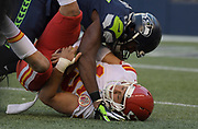 Aug 25, 2017; Seattle, WA, USA; Seattle Seahawks defensive end David Bass (47) sacks Kansas City Chiefs quarterback Patrick Mahomes (15)  during a NFL football game at CenturyLink Field. The Seahawks defeated the Chiefs 26-13.