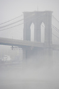 Brooklyn Bridge seen from the Brooklyn side during a morning fog