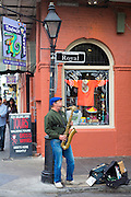 Jazz musician saxophonist plays saxophone in live performance on street corner, Royal Street, French Quarter, New Orleans, USA