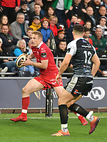 Rugby Union - 2018 / 2019 - European Champions Cup Qualification Final - Ospreys vs Scarlets<br /> <br /> Johnny McNicholl,of Scarlets  attacks… at the Liberty Stadium<br /> <br /> Credit: COLORSPORT/WINSTON BYNORTH