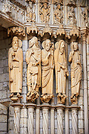 North Porch, Central Portal, left Jambs- General View c. 1194-1230. Cathedral of Chartres, France . Gothic statues of figures, from the left.1) the Old-Testament Priest/King Melchisedech holding a cup..2) Abraham sacrificing Isaac.3) Moses with the brazen serpent and the tablets of the Law.4) Samuel, sacrificing a lamb.5) King David.This portal was cleaned in the 1990's. The cleaning uncovered the yellowish sizing material that at one time served as a base for the paint and gilding which once decorated the figures.. A UNESCO World Heritage Site. . .<br /> <br /> Visit our MEDIEVAL ART PHOTO COLLECTIONS for more   photos  to download or buy as prints https://funkystock.photoshelter.com/gallery-collection/Medieval-Middle-Ages-Art-Artefacts-Antiquities-Pictures-Images-of/C0000YpKXiAHnG2k