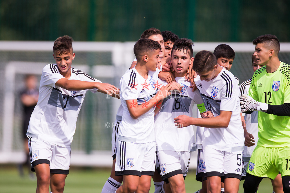 WREXHAM, WALES - Thursday, August 15, 2019: Cyprus' captain Michael Chiromerides celebrates scoring the first goal during the UEFA Under-15's Development Tournament match between Cyprus and Malta at Colliers Park. (Pic by Paul Greenwood/Propaganda) Panagiotis Karagiorgis, Andreas Christou, Andreas Ioannou, goalkeeper Pantelis Michail, Zannetos Savva