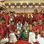 Employees in the family business line up for a group picture with the bride and groom after the engagement ceremony. Madurai 2009