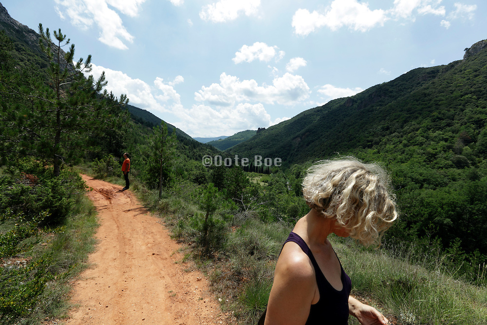people hiking in mountain landscape