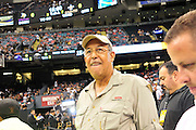 Retired General Honre, watches the New Orleans Saints warm up to play the Minnessota Vikings he came with Flim Maker Spike Lee. Le just did a documentary on Hurricane Katrina nnd General Honre lead the recovery efforts in New Orleans. headon the sideline, just prior to the kick off to the popening of the NFL season. The Saints beat the Minnessota Viking 14-9- in New Orleans at the Super dome Thursday Sept. 9 2010. Phot © Suzi Altman