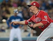 The Angels' Joe Smith pitches against the Dodgers during their Freeway Series game Friday night at Dodger Stadium.<br /> <br /> <br /> ///ADDITIONAL INFO:   <br /> <br /> freeway.0402.kjs  ---  Photo by KEVIN SULLIVAN / Orange County Register  --  4/1/16<br /> <br /> The Los Angeles Angels take on the Los Angeles Dodgers at Dodger Stadium during the Freeway Series Friday.<br /> <br /> <br />  4/1/16