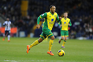 Norwich city's Nathan Redmond makes a break. Barclays Premier league, West Bromwich Albion v Norwich city at the Hawthorns in West Bromwich, England on Sat 7th Dec 2013. pic by Andrew Orchard, Andrew Orchard sports photography.