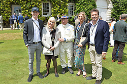 Left to right, LUCAS STEWART (son of Paul Stewart), his grandparents SIR JACKIE & LADY STEWART and MARK & ANNE STEWART at the Cartier hosted Style et Lux at The Goodwood Festival of Speed at Goodwood House, West Sussex on 26th June 2016.