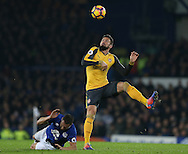 Olivier Giroud of Arsenal fouls Phil Jagielka of Everton before controlling the ball during the English Premier League match at Goodison Park Stadium, Liverpool. Picture date: December 13th, 2016. Pic Simon Bellis/Sportimage
