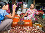 14 JUNE 2013 -  PANTANAW, AYEYARWADY, MYANMAR: A woman sells onions in the market in Pantanaw, in the Ayeyarwady Region of south-west Myanmar. It is the hometown of former United Nations Secretary-General U Thant and of the renowned artist U Ba Nyan.   PHOTO BY JACK KURTZ