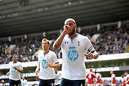 Tottenham Hotspur's Younes Kaboul celebrates after he scores his sides 3rd goal to make it 3-1 . Barclays premier league match ,Tottenham Hotspur v Fulham at White Hart Lane in Tottenham, London  on Saturday 19th April 2014.<br /> pic by John Patrick Fletcher, Andrew Orchard sports photography.