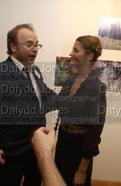 Alex Proud and Helena Christensen. Helena Christensen: An Eye For Beauty - private view. Sony Ericsson Proud Camden, Stables Market, The Gin House, London, NW1. 1 September 2005. ONE TIME USE ONLY - DO NOT ARCHIVE  © Copyright Photograph by Dafydd Jones 66 Stockwell Park Rd. London SW9 0DA Tel 020 7733 0108 www.dafjones.com