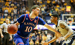 Jan 15, 2018; Morgantown, WV, USA; Kansas Jayhawks guard Sviatoslav Mykhailiuk (10) attempts to drive baseline during the first half against the West Virginia Mountaineers at WVU Coliseum. Mandatory Credit: Ben Queen-USA TODAY Sports