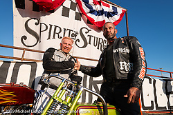 Sons of Speed racer Freddie Bollwage with Carey Maynell beside Carey's 1927 Harley-Davidson board track racer at the Spirit of Sturgis races at the fairgrounds during the Sturgis Black Hills Motorcycle Rally. Sturgis, SD, USA. Monday, August 5, 2019. Photography ©2019 Michael Lichter.