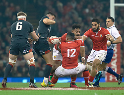 Owen Watkin of Wales rips the ball from Siale Piutau of Tonga <br /> <br /> Photographer Simon King/Replay Images<br /> <br /> Under Armour Series - Wales v Tonga - Saturday 17th November 2018 - Principality Stadium - Cardiff<br /> <br /> World Copyright © Replay Images . All rights reserved. info@replayimages.co.uk - http://replayimages.co.uk