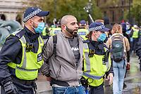 Police make arrests at the anti-lockdown protest  Trafalgar Square, London 24th oct 2020 photo Mark Anton Smith