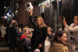 © Licensed to London News Pictures. 16/04/2021. London, UK. A woman swings a bra above her head as member so the public enjoy a night out in Soho in Central London. Earlier this week Lockdown restrictions were eased to allow non essential retail and outdoor dining to reopen. Photo credit: George Cracknell Wright/LNP