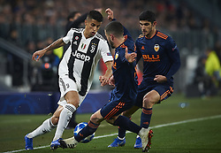 November 27, 2018 - Turin, Italy - Joao Cancelo of Juventus (L) disputes the ball with Jose Luis Gaya (C) and Gonzalo Guedes (R) of Valencia during the UEFA Champions League match between Juventus and Valencia CF at Allianz Juventus Stadium  in Turin, Italy on November 27, 2018  (Credit Image: © Jose Breton/NurPhoto via ZUMA Press)