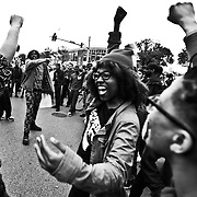 Protesters rejoice hours after charges were brought against six Baltimore Police officers in connection to the death of Freddie Gray at the intersection of West North Street and Pennsylvania Avenue in Baltimore on Friday, May 1, 2015. Credit: Byron Smith