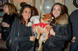 Left to right, FRANCESCA MALEK and her dog Ted and ROXY MALEK and her dog Foxy at a recption hosted by the Dogs Trust held at George, 87-88 Mount Street, London on 23rd November 2015.
