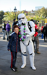 09 February 2016. New Orleans, Louisiana.<br /> Mardi Gras Day. Ben and a Storm Trooper in Jackson Square in the French Quarter.<br /> Photo©; Charlie Varley/varleypix.com