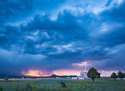 A large thunderstorm flashes lightning after sunset at Mission Plaza on the north side of Westcliffe. Presented at Art for the Sangres as a 20x30 photo canvas gallery wrap: $500.