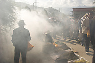 People walk through sweet smelling juniper smoke at a festival at Ganden Monastery in Lhasa, Tibet.
