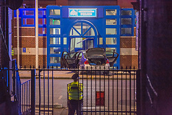 © Licensed to London News Pictures. 11/11/2020. London, UK. The scene at Edmonton police station in north London after a car crashed into the front entrance. Videos of the incident show a man getting out from the car and setting light to a substance on the road before being detained by police. Photo credit: Marcin Nowak/LNP