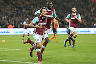 Mark Noble, West Ham United captain (l)  celebrates after scoring his sides 1st goal from a penalty with Cheikhou Kouyate of West Ham UnitedPremier league match, West Ham Utd v Hull city at the London Stadium, Queen Elizabeth Olympic Park in London on Saturday 17th December 2016.<br /> pic by John Patrick Fletcher, Andrew Orchard sports photography.