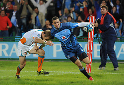 PRETORIA, South Africa, 28 May 2011. Bjorn Basson of the Bulls hands off Riaan Viljoen of the Cheetahs for his try during the Super15 Rugby match between the Bulls and the Cheetahs at Loftus Versfeld in Pretoria, South Africa on 28 May 2011..Photographer : Anton de Villiers / SPORTZPICS