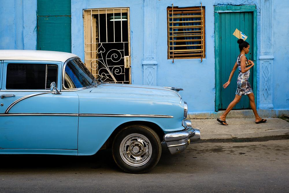 HAVANA, CUBA - CIRCA JANUARY 2020: Woman walking in the streets of Havana.